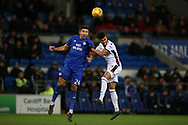 Marko Grujic of Cardiff city (l) challenges Derik Osede of Bolton Wanderers. EFL Skybet championship match, Cardiff city v Bolton Wanderers at the Cardiff city Stadium in Cardiff, South Wales on Tuesday 13th February 2018.<br /> pic by Andrew Orchard, Andrew Orchard sports photography.