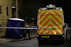 © Licensed to London News Pictures. 08/10/2021. Oxford, UK. A Thames Valley Police van parked at the crime scene cordon in Bayswater Road, Barton in Oxfordshire. Police were called just before 6:00pm today, Friday 08/10/2021, to reports of a man being stabbed, the victim, a man aged in his thirties, died of his injuries at the scene. Photo credit: Peter Manning/LNP