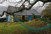 Old cottage and nets at Carsaig Bay fishing pier, Isle of Mull, Scotland.