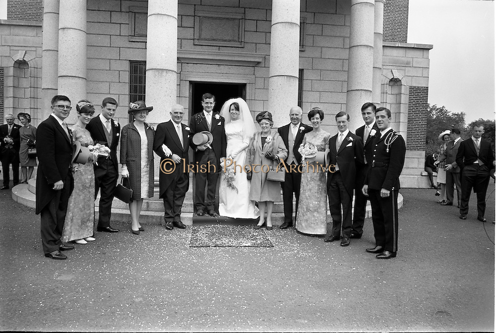 05/07/1967<br /> 07/05/1967<br /> 05 July 1967<br /> Wedding of George Walsh, eldest son of Mr and Ms Kevin G. Walsh, St. Rita's, Firhouse Road, Templeogue, Co. Dublin and Miss Arlene McMahon, elder daughter of Det. Chief Supt. Philip McMahon, Head of Special Branch, Dublin Castle and Mrs McMahon of Lisieux, Templeville Park, Templeogue, Co. Dublin who were married at the Carmelite Church, Terenure College, Dublin. An Taoiseach Mr Jack Lynch and Mrs Lynch; Mr Liam Cosgrave, leader Fine Gael and Mrs Cosgrave were among the 120 guests. Rev Fr H.E. Wright, O. Carm., Moate, officiated at the ceremony. The reception was held at Downshire Hotel, Blessington, Co. Wicklow. The wedding party and couple's parents pose for a photo outside the church.