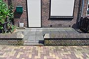 Nederland, Nijmegen, 24-7-7-2017Stenen tuinen in het Willemskwartier. Doordat mensen hun tuintjes volleggen met sierbestrating kan het regenwater moeilijker via de grond afgevoerd worden.Foto: Flip Franssen