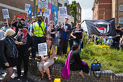 Luton, UK. 27th June, 2015. Local residents join anti-racist activists from Unite Against Fascism and other anti-fascist groups to protest against a march by far-right group Britain First. A large police presence kept the two groups apart.