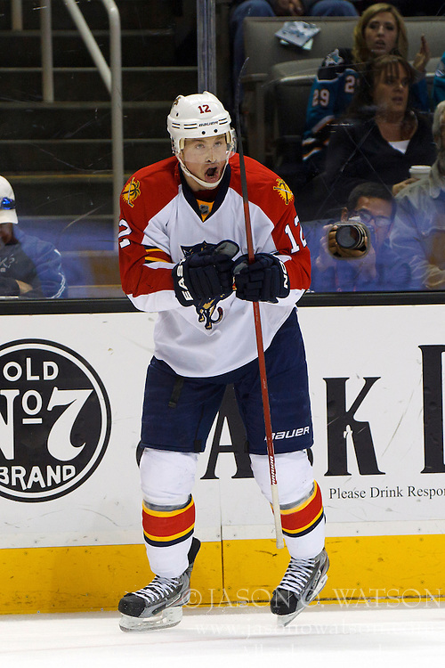 Dec 3, 2011; San Jose, CA, USA; Florida Panthers right wing Jack Skille (12) celebrates after scoring a goal against the San Jose Sharks during the second period at HP Pavilion. Florida defeated San Jose 5-3. Mandatory Credit: Jason O. Watson-US PRESSWIRE