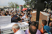 """Close family of Florin Cioaba cry at his side as his coffin is prepared to be placed into the grave. Arrival at the cemetery and Florin Cioaba is buried with a huge crowd accompanying him.<br /><br />Florin Ciaoba's funeral and the crowning of two kings. Daniel and Dorian were crowned, Danile with the bigger crown is King of Romanian Roma Gypies whilst his older Brother Dorian has the smaller crown and is King of Gypsies of the world and deals with foriegn affairs. His hearse (a lorry) packed with security guards is taken from The Cioaba family home to the cemetery<br /><br />Florin Tănase Cioabă (1954 – 18 August 2013) was a Romanian Romani Pentecostal minister and self-proclaimed """"King of Roma around the world"""". He died on 18 August 2013 of cardiac arrest at Akdeniz Üniversitesi in Antalya. He was 58 years old.<br /><br />In September 2003, Florin Cioaba sparked controversy when he married his 12 year-old daughter Ana-Maria to Mihai Bitrita, a Roma boy aged 15. However, following the wave of criticism, he promised to work to uproot the tradition of child marriages among the Roma. Florin Cioaba also encouraged Roma families to send their children to school during his attempt to fight poverty resulting from a lack of education.<br /><br />Cioaba was elected president of the International Romani Union in April this year"""