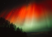Green and red aurora over Wishbone Hill of the Talkeetna Mountains during geomagnetic storm in early morning hours of November 24, 2001, Alaska.