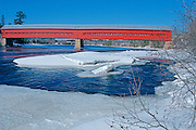 red covered bridge over Gatineau River<br /> Wakefield <br /> Quebec<br /> Canada