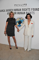 Left to right, NADJA SWAROVSKI and BIANCA JAGGER at Arts for Human Rights gala dinner in aid of The Bianca Jagger Human Rights Foundation in association with Swarovski held at Phillips de Pury & Company, Howick Place, London on 13th October 2011.