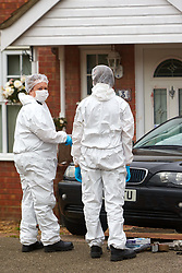 © Licensed to London News Pictures. 20/10/2019. Milton Keynes, UK. Police forensic officers investigate the front of a car parked at the scene in Archford Croft in Emerson Valley where two 17 year old boys were stabbed to death overnight. Two adult males where also injured. Thames Valley Police have begun a doyuble murder investigation but have yet to make any arrests.  Photo credit: Cliff Hide/LNP