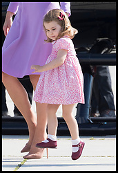 July 21, 2017 - Hamburg, Germany - Image licensed to i-Images Picture Agency. 21/07/2017. Hamburg, Germany. Princess Charlotte skips across the tarmac as the The Duke and Duchess of Cambridge with Prince George and Princess Charlotte leave Hamburg, Germany, on the final day of their Royal Tour  Picture by Stephen Lock / i-Images (Credit Image: © Stephen Lock/i-Images via ZUMA Press)