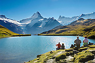 First Lake, above Grinderwald in the Alps with hikers having a picnic .<br /> <br /> Visit our SWITZERLAND  & ALPS PHOTO COLLECTIONS for more  photos  to browse of  download or buy as prints https://funkystock.photoshelter.com/gallery-collection/Pictures-Images-of-Switzerland-Photos-of-Swiss-Alps-Landmark-Sites/C0000DPgRJMSrQ3U