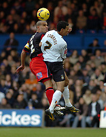 Photo: Kevin Poolman.<br />Luton Town v Queens Park Rangers. Coca Cola Championship. 11/11/2006. Marcus Bignot of QPR and Carlos Edwards of Luton both go up for the ball.