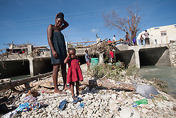 October 7, 2016 - Port Salute, Haiti - A mother and her child wash in the river after hurricane Matthew destroyed and flooded their houses, in Port Salute, Haiti, on October 7, 2016. Hurricane Matthew killed almost 900 people and displaced tens of thousands in Haiti before plowing northward on Saturday just off the southeast U.S. coast, where it caused major flooding and widespread power outages. (Credit Image: © Bahare Khodabande/NurPhoto via ZUMA Press)