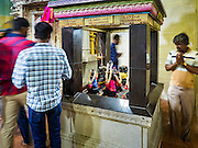 "27 DECEMBER 2015 - SINGAPORE, SINGAPORE:  People pray at Sri Veeramakaliamman Temple in Singapore. Sri Veeramakaliamman Temple in the ""Little India"" section of Singapore, was one of the first Hindu temples in Singapore and is dedicated to the Goddess Kali, the Hindu ""Destroyer of Evil.""  It's on Serangoon Road, which at one time was the center of Singapore's Indian community and served Indian immigrants who worked in the cattle trade that was based around Serangoon Road in the 19th century. Now the temple is a popular tourist site.     PHOTO BY JACK KURTZ"