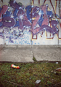 Graffiti and litter on the remnants of the Berlin Wall, Berlin, Germany