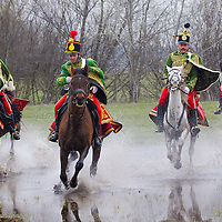 People dressed as Hungarian hussars, or cavalrymen cross a pond of water during the re-enactment of the historic battle against Austrian soldiers of the Habsburg dynasty in Tapiobicske, 80 km (50 miles) southeast of Budapest, Hungary on April 04, 2013. ATTILA VOLGYI
