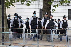 © Licensed to London News Pictures. 11/05/2021. London, UK. Police officers patrol the Mall ahead of the state opening of Parliament . Photo credit: George Cracknell Wright/LNP
