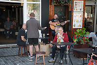 People drinking dancing and live music at  Sweenys Bar Liverpool