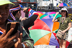 © Licensed to London News Pictures. 05/01/2014. An Anti-Government protester raises her arm for a photo taken in front of a stage set up at one of the main intersections of Bangkok during the third day of the 'Bangkok Shutdown' as anti-government protesters continue with their 'shutdown' of Bangkok.  Major intersections in the heart of the city have been blocked in their campaign to oust Prime Minister Yingluck Shinawatra and her government in Bangkok, Thailand. Photo credit : Asanka Brendon Ratnayake/LNP