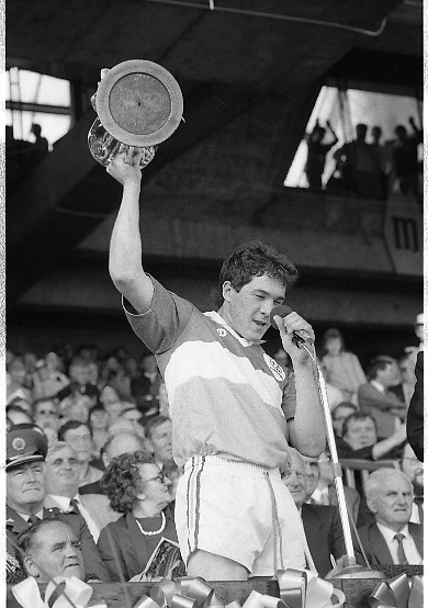All Ireland Hurling Finals.1986..07.09.1986..09.07.1986..7th September 1986..September,every year,is the highlight of the GAA calendar with The All Ireland Finals being held in both codes. The senior and minor finals in each code are both played for on the same day. Each finalist has battled through provinical and knock out stages to reach the final.It is widely regarded as the pinnacle of a players career to reach and win an All Ireland Championship..In this years hurling finals,Cork played Offaly in the minor championship and a much fancied Galway team took on Cork in the senior final. Both matches were well fought and close encounters...In the minor final Offaly ran out winners against Cork with a score of 3.12 (21) to 3.9 (18)...Photograph shows Offaly captain Michael Hogan, with cup aloft,making the customary after match speech,in which he praised a gallant Cork team for their efforts in what was a memorable match.