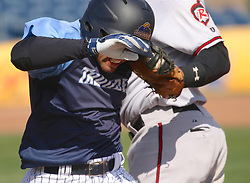 April 8, 2018 - Trenton, New Jersey, U.S - In the 10th inning of the game between the Trenton Thunder and the Richmond Flying Squirrels at ARM & HAMMER Park, Thunder shortstop VINCE CONDE is tagged out at first base on his sacrifice bunt. The Squirrels won the game 3-2 in the 10th. (Credit Image: © Staton Rabin via ZUMA Wire)