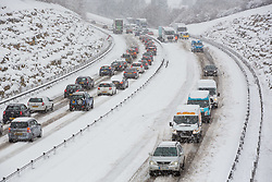© Licensed to London News Pictures 10/12/2017, Ciirencester, UK. Lorries and cars queue and ssome tart to get stuck in the snow on the A417 outside Cirencester, Gloucestershire. Photo Credit : Stephen Shepherd/LNP