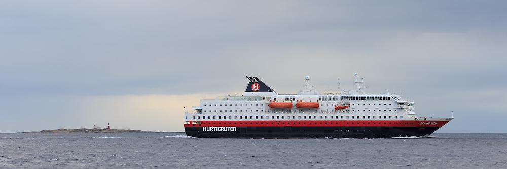 The passenger boat MS Richard With sailing outside Flø, Norway   Hurtigruteskipet MS Richard With seiler forbi Flø, Norge. Grasøyane fyr i bakgrunnen.