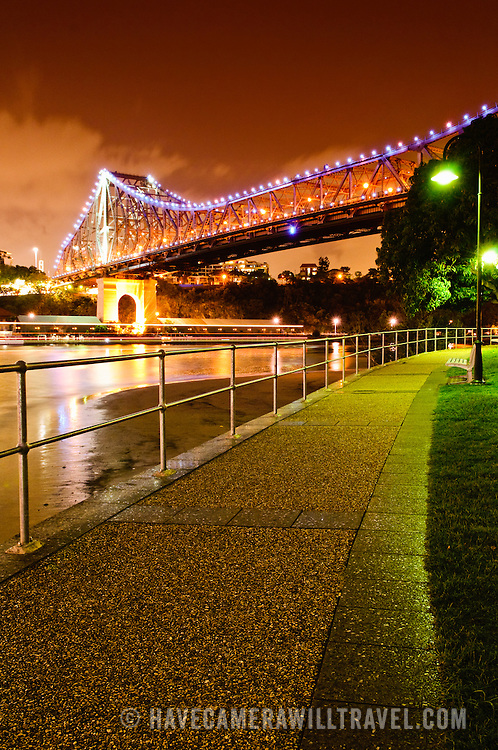 Brisbane's Story Bridge at night with walkway along the waterfront