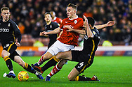 Mike-Steven Bahre of Barnsley (21) is fouled by Ryan McGowan of Bradford City (4) during the EFL Sky Bet League 1 match between Barnsley and Bradford City at Oakwell, Barnsley, England on 12 January 2019.