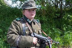 Young Reenactor portraying a member of 1 Kompanie Großdeutschland on gate duty at Fort Paull<br /> <br />   04May 2015<br />   Image © Paul David Drabble <br />   www.pauldaviddrabble.co.uk