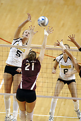 24 November 2006: Sara Lungren smashes the ball towards Jamie Adams during a Semi-final match between the Missouri State Bears and the Wichita State Shockers. The Tournament was held at Redbird Arena on the campus of Illinois State University in Normal Illinois.<br />