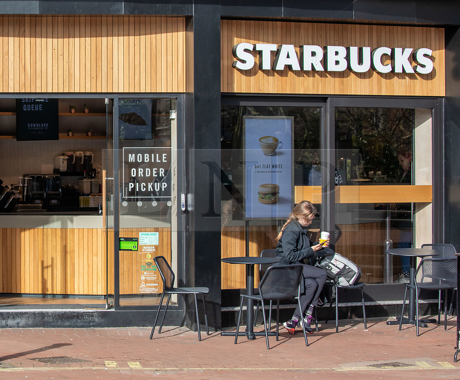 © Licensed to London News Pictures. 17/03/2020. London 09.22am, UK. A commuter at a Starbucks next to Embankment Tube normally teaming with workers. London remains incredibly quiet this morning after Boris Johnson announced people should avoid socialising, work from home, avoid travelling and families to isolate if one of them is ill as the Coronavirus disease pandemic crisis continues. Photo credit: Alex Lentati/LNP