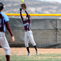 041814  Adron Gardner/Independent<br /> <br /> Ganado Hornet Karla Curley  (7) reaches to catch a Window Rock Scout fly ball in Fort Defiance Friday.