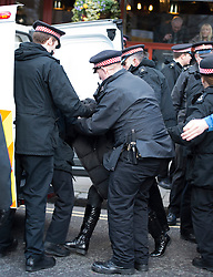 © London News Pictures. 26/02/2014. London, UK.  A woman being arrested and placed in a police van during demonstrations aoutsied  the Old Bailey in London where Michael Adebolajo and Michael Adebowale were sentenced for the murder of Fusilier Lee Rigby who was attacked near Woolwich Barracks in south-east London on May 22, 2013. Photo credit: Ben Cawthra/LNP