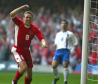 Photo: Scott Heavey<br />Wales V Azerbaijan. 29/03/03.<br />Craig Bellamy celebrates after his opening minute goal during this afternoons Euro 2004 Group 9 qualifying match at the Millenium stadium in Cardiff.