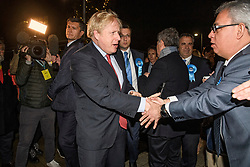 © Licensed to London News Pictures. 13/12/2019. London, UK. British Prime Minister BORIS JOHNSON and his partner CARRIE SYMONDS arrive at the General Election count for the constituency of Uxbridge and South Ruislip. A general election was called for December 12th following a deadlock in Parliament over the UK's decision to leave the EU. Photo credit: Ben Cawthra/LNP