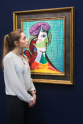 Sotheby's, London, January 28th 2016. A woman admires Picasso's Tête De Femme, valued at between £16 - 20 million, to be auctioned by Sotheby's in London as part of their sale of Impressionist, Modern, Surrealist and Contemporary art. ///FOR LICENCING CONTACT: paul@pauldaveycreative.co.uk TEL:+44 (0) 7966 016 296 or +44 (0) 20 8969 6875. ©2015 Paul R Davey. All rights reserved.