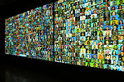 """Mexican artist Rafael Lozano-Hemmer piece """"Reporters with Borders, Shadow Box 6"""" at Haunch of Venison Gallery, London, UK. This interractive installation made the reporters speak from their individual sqyares on the screen when the viewer moved around the room."""