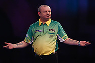 Darren Webster holds his arms out after his second round match against Vincent Van de Voort, during the Darts World Championship 2018 at Alexandra Palace, London, United Kingdom on 18 December 2018.