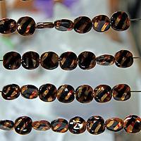 Africa, Kenya, Nairobi. Painted Beads hanging to dry at Kazuri bead making factory in Karen district of Nairobi.