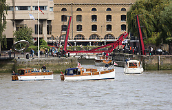 © Licensed to London News Pictures. 06/09/2017. LONDON, UK.  Dunkirk Little Ships and their owners arrive at St Katharine Docks on the River Thames in preparation for the Classic Boat Festival this weekend. The Totally Thames Classic Boat Festival includes 40 vintage work boats, sailing and motor yachts and 14 of the Dunkirk Little Ships.  Photo credit: Vickie Flores/LNP