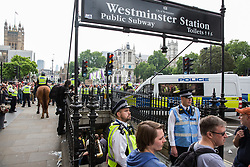 London, UK. 9th June, 2018. Police officers control a group of supporters of Tommy Robinson, former leader of the far-right English Defence League, who had broken away from the March for Tommy Robinson whilst escorting anti-fascists holding a counter-protest into Westminster London Underground station.