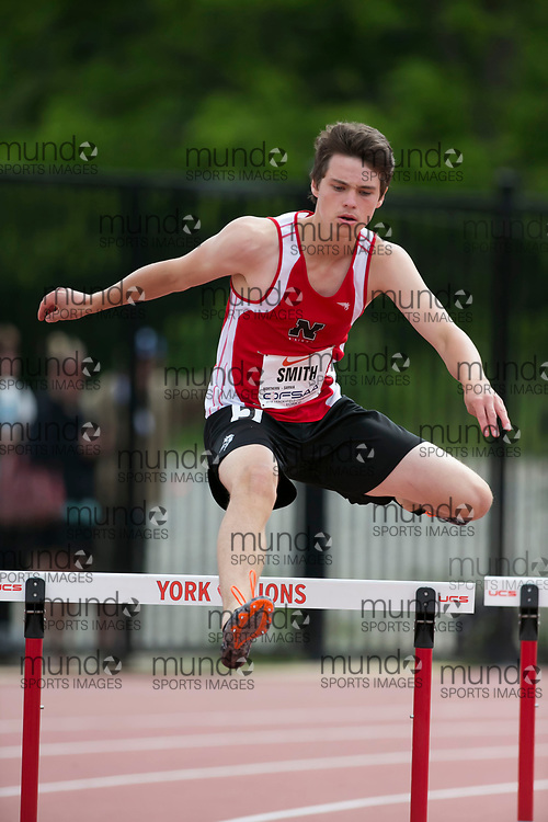(York, Canada---09 June 2018) Anthony Smith running in the midget boys 300m hurdles heats at the 2018 OFSAA Ontario High School Track and Field Championships at York Lions Stadium. (Photo by Sean Burges/Mundo Sport Images)