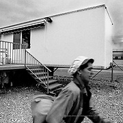 The 70 workers hired in Morocco for the fruit harvest in Lleida, lived in caravans. The campsite, situated at some 200 meters from the factory, was enclosed with a wire fence and locked at night. Spain.