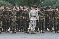 As rain falls, recruits undergo basic training at Marine Corps Recruit Depot Parris Island in South Carolina. (September 2014)