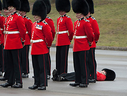 © London News Pictures. 17/03/2012. Aldershot, UK. A soldier fainting at a St Patrick's Day parade at Mons Barracks in Aldershot, Hampshire, UK, on March 17th, 2012 which was attended by The Duchess of Cambride CATHERINE (KATE) MIDDLETON.  Photo credit : Ben Cawthra/LNP.
