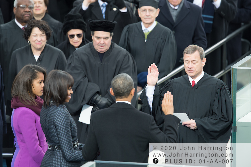 Chief Justice John Roberts swears in President Obama for a second term during the 57th Presidential Inauguration of President Barack Obama at the U.S. Capitol Building in Washington, DC January 21, 2013.