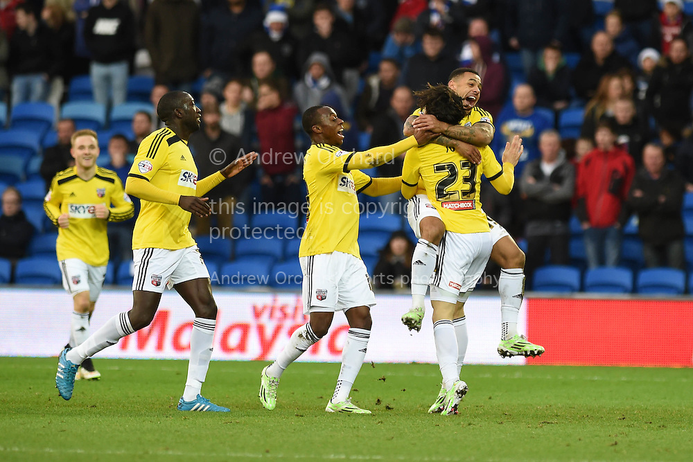 Jota Peleteiro Ramallo of Brentford (23) celebrates with his teammates after he scores his teams 3rd goal. Skybet football league championship match, Cardiff city v Brentford at the Cardiff city stadium in Cardiff, South Wales on Saturday 20th December 2014<br /> pic by Andrew Orchard, Andrew Orchard sports photography.