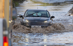 © Licensed to London News Pictures 27/12/2020.        Crockenhill, UK. The B258 near Crockenhill in Kent is flooded causing traffic problems for drivers. Storm Bella has battered Kent with gale force winds and heavy rain flooding roads and bringing down trees. Photo credit:Grant Falvey/LNP