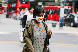 © Licensed to London News Pictures. 09/09/2020. London, UK. A woman wearing a 'Thank You NHS' face covering on Wood Green High Road, in the London Borough of Haringey as the number of COVID19 cases increases. As at Sunday, September 6, the government reported a three-month high in coronavirus cases in England, with 2,988 lab-confirmed cases reported on that day, the highest number of new cases since May. According to the figures published by the COVID-19 Symptom Study app, Newham, has most active cases among London boroughs, with 97 per 100,000 people.<br /> The London Borough of Haringey has 75.7 cases per 100,000 people. Britain could be facing a nationwide curfew as part of the efforts to avoid a second wave. Photo credit: Dinendra Haria/LNP