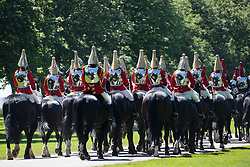 The Household Cavalry Mounted Regiment proceeds along the Long Walk following a dress rehearsal at Windsor Castle for Trooping the Colour on 9th June 2021 in Windsor, United Kingdom. A socially distanced and scaled down Trooping the Colour ceremony to mark the Queen's birthday will take place at Windsor Castle on 12th June incorporating many of the elements from the annual ceremonial parade on Horse Guards, with F Company Scots Guards Trooping the Colour of the 2nd Battalion Scots Guards in the Castle Quadrangle.